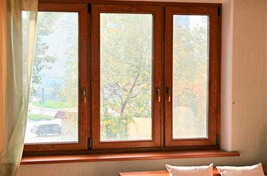 Пластиковое окно Rehau ламинированное моренный дуб